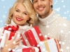 happy man and woman with many gift boxes
