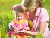happy family. Mom and baby in a meadow in the summer in the park