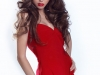 Sexy Woman with long brown hair in red dress isolated on white b
